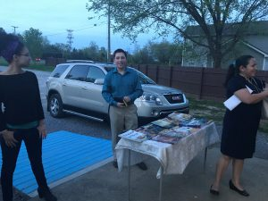 Chris selling books at a local church